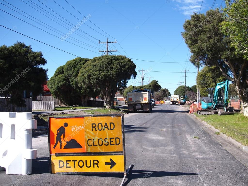 Road works in road with a detour sign