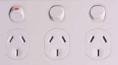 Three fold low voltage power wall outlets with one switched on