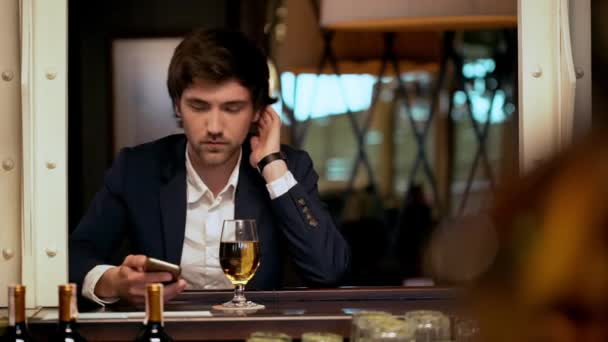 Young successful businessman speaking on phone in cafe. Slow motion.