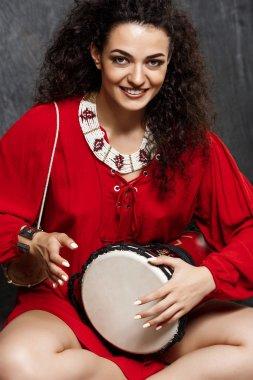 brunette girl playing drum