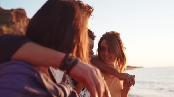 Friends walking at seaside