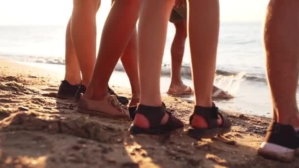 Friends walking at seaside at sunrise