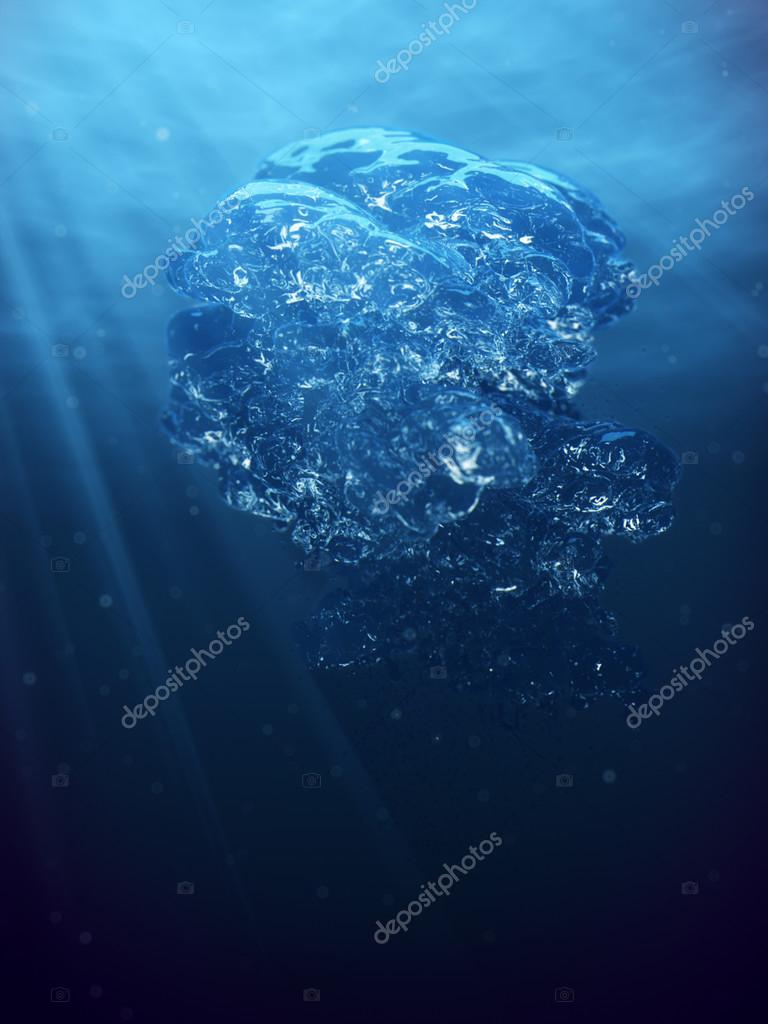 Air bubbles and sun ray in deep blue sea