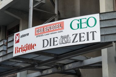 Berlin, Germany - April 18, 2019: German magazines and newspapers signs outside a newsstand