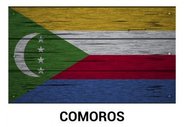Comoros flag on wood texture background