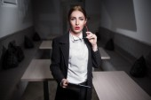 Business lady in suit and with red lips and with tablet;