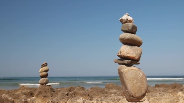 Tower of stones on a background of ocean