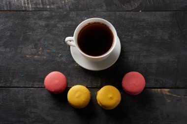 smile of multicolored macaroon and coffee