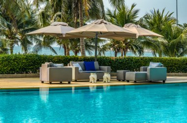 Outdoor sofa set at poolside