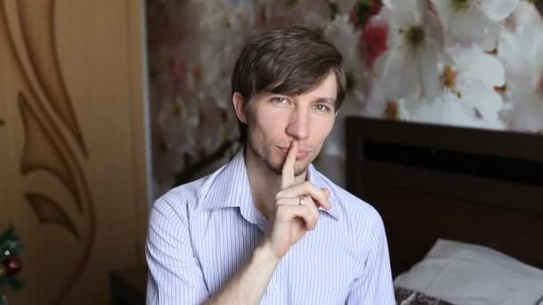 Man puts a finger to his lips, gets flowers - tulips and then winks