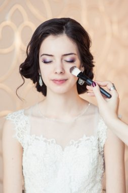 Wedding make-up of the bride