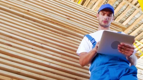 industrial worker in uniform checking wooden box