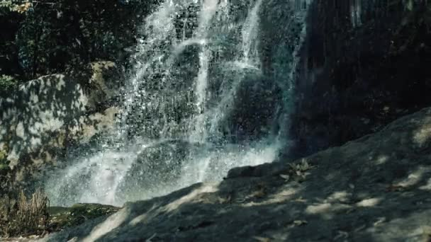 Waterfall in the park in nature, handles flowing down the rocks, mountain waterfall.