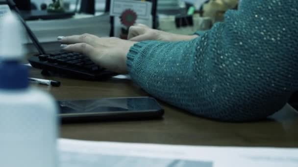 Female hands with manicure are typing on the keyboard, office worker girl fills out the documentation, employee of a consulting company