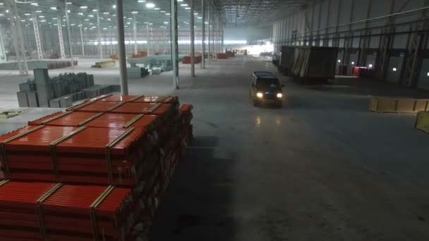aerial view of car is moving inside a large new modern industrial warehouse