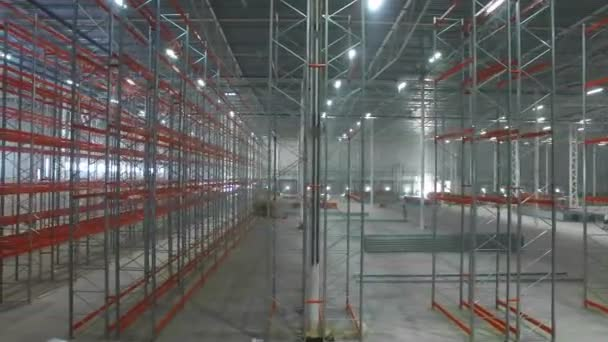 aerial view inside a large new modern industrial warehouse