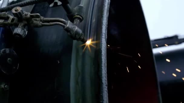 Industrial worker cutting steel duct pipe by using metal torch