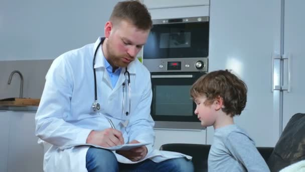 home doctor came to sick boy and his mother. he examines a child and records readings in notebook