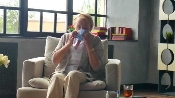 sick elderly woman much coughing and blowing nose into handkerchief