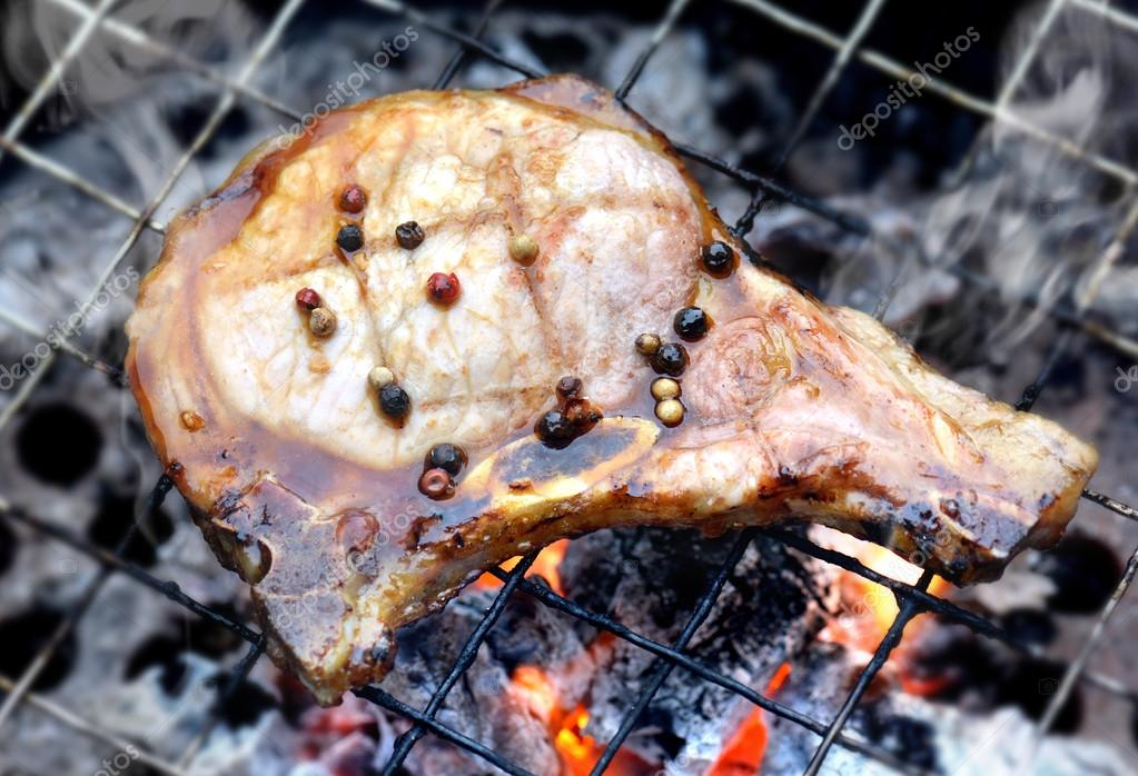 Pork chops steak grill on charcoal fire