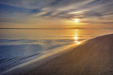 Serene beach and sky