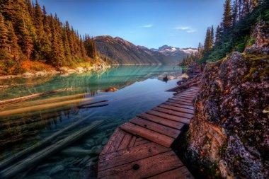 Wooden walkway along a scenic mountain