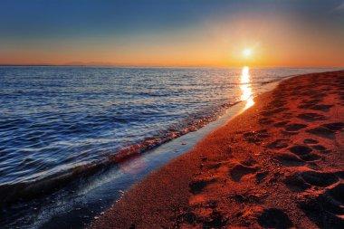 Warm ocean beach sunrise