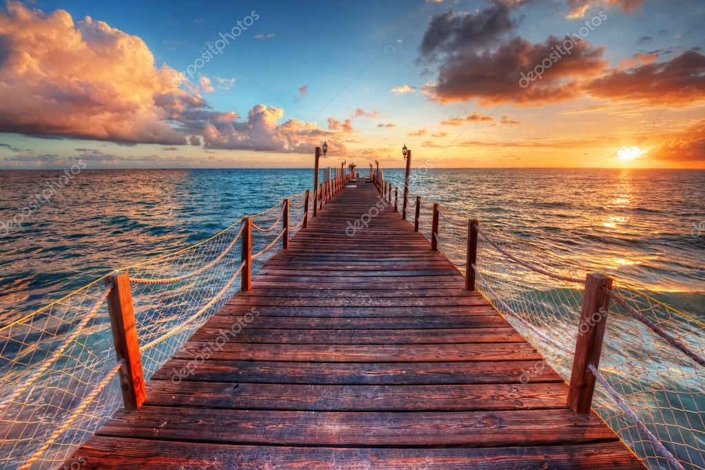 sunset over sea pier