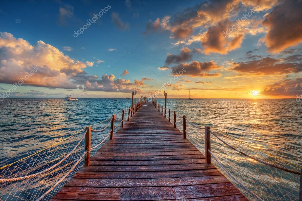 Brilliant sunrise on a sea pier