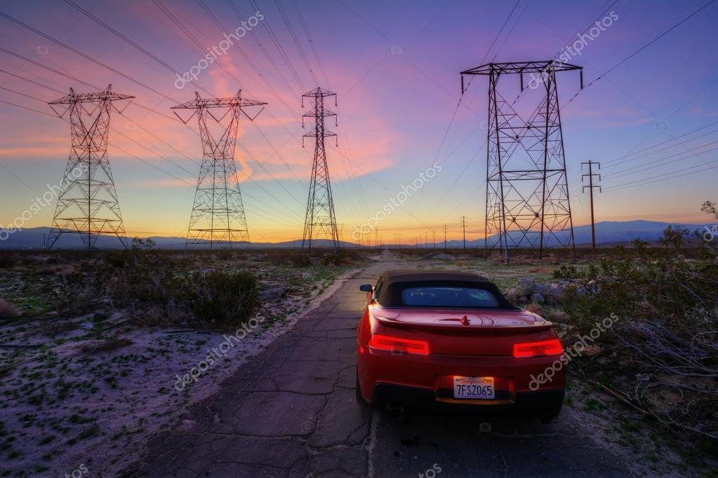 Mountain road sunset  and car