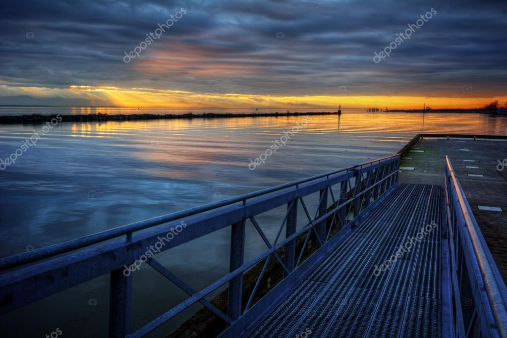 Azure waters behind a wooden pier