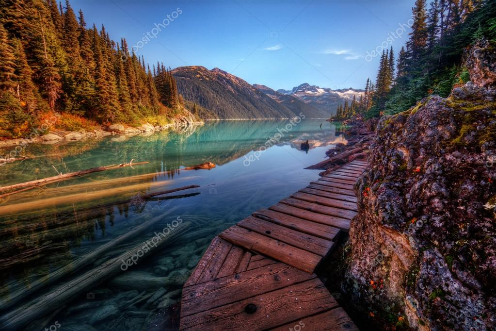 Wooden walkway along a scenic mountain