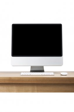 A desktop computer, LCD monitor on the wood desk(table) isolated white.