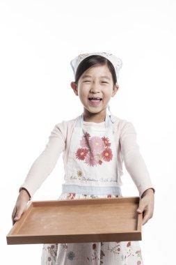 A child in a kitchen.
