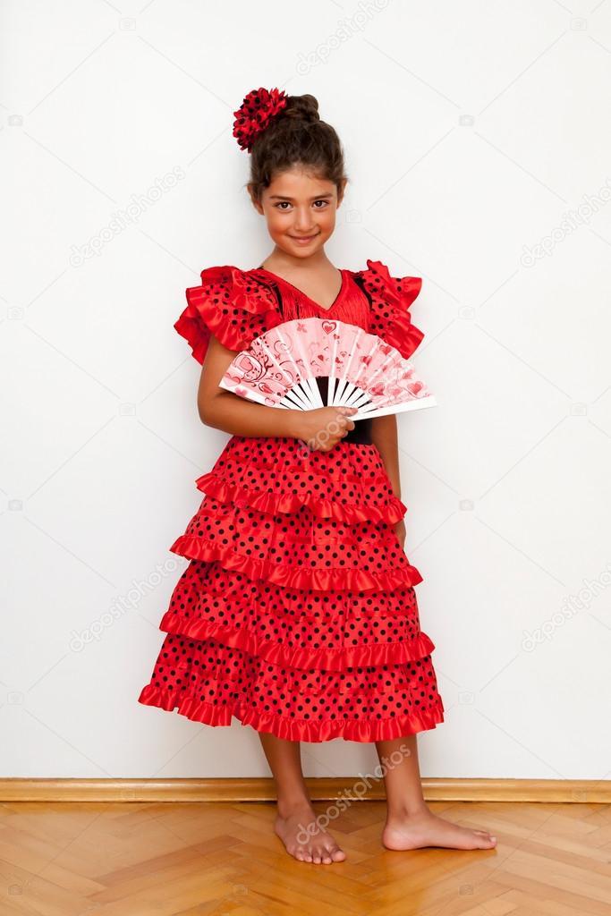 252f5bf8b Cute girl in spanish costum — Stock Photo © Koraysa  110633016