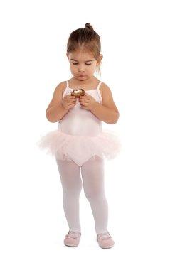 Cute ballerina eating chocolate