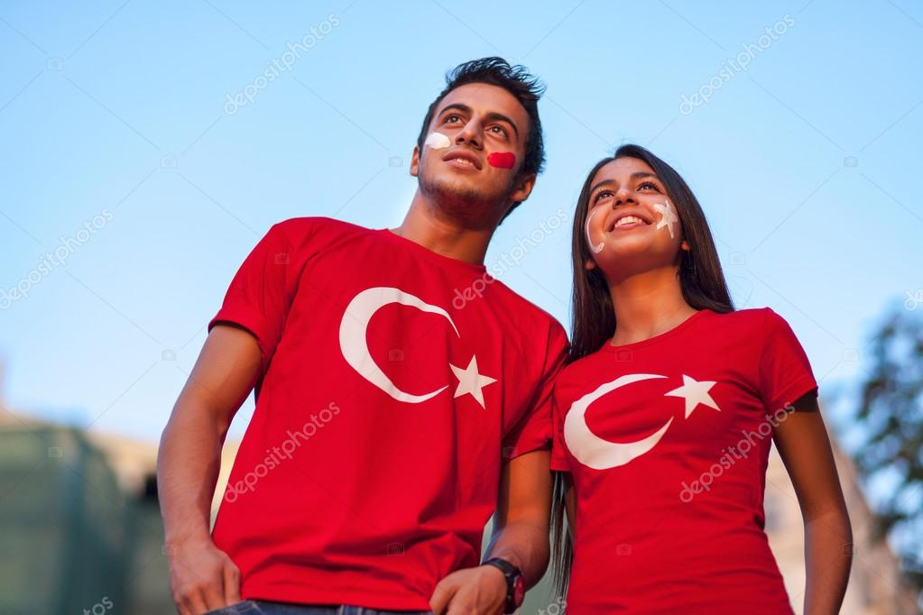 Couple wearing Turkish flag t-shirts