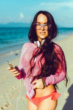 girl  listening music   on the beach