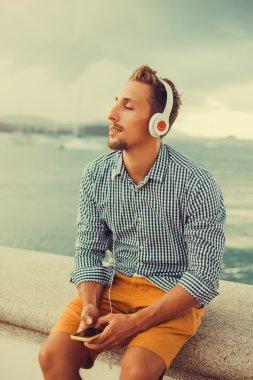 guy  listening music in headphones