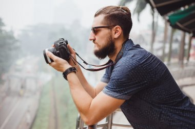happy young guy with big camera