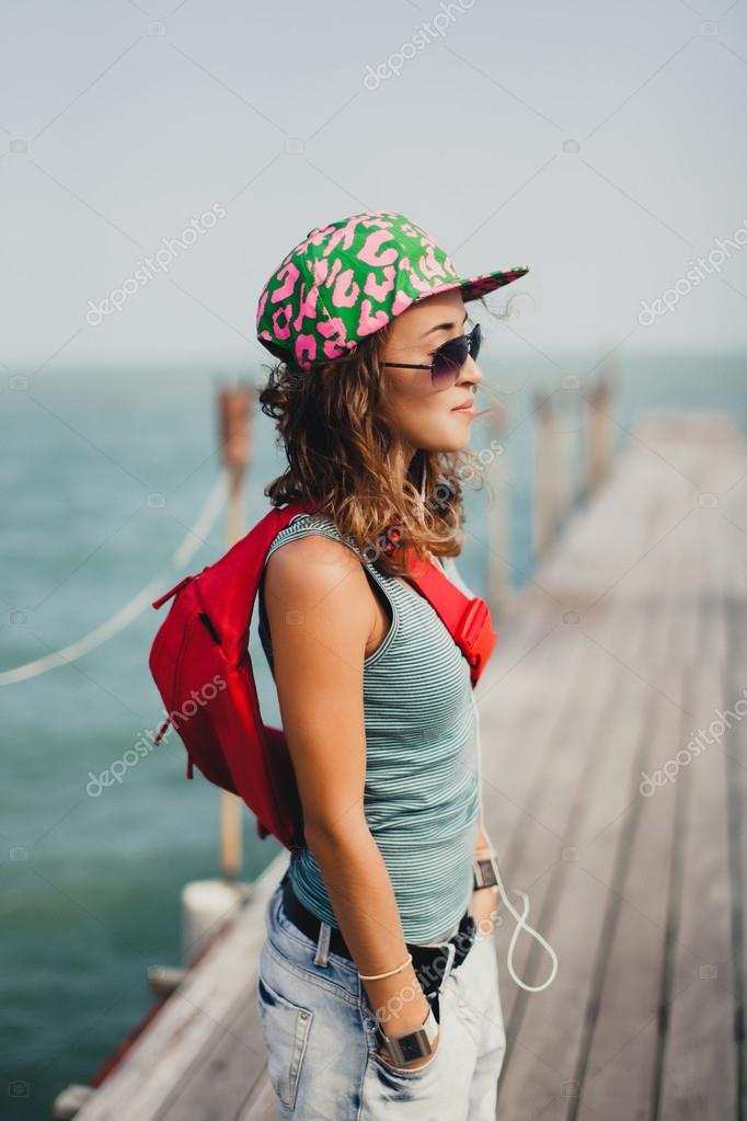 beautiful girl  posing on the sea pier
