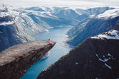 Photo girl   on a rock , Norway fjords