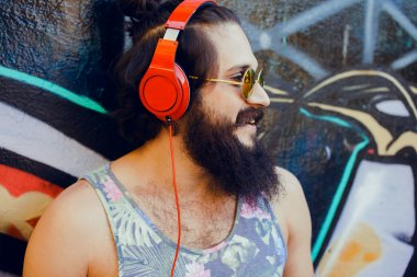 guy with  listening  music with headphones