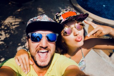 couple in caps  making the selfi