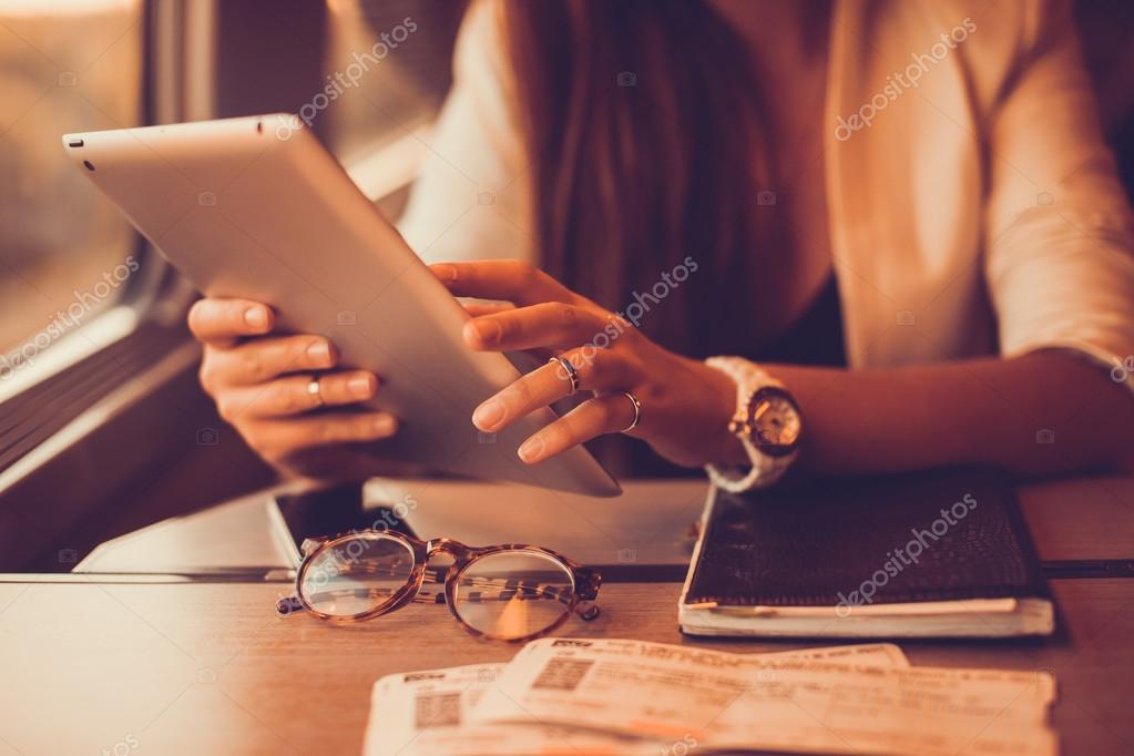 young girl works on the tablet