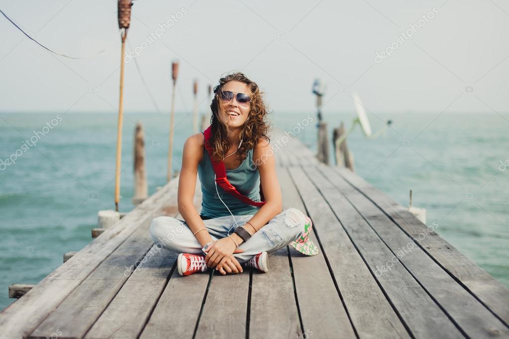 beautiful girl  posing on the sea pier