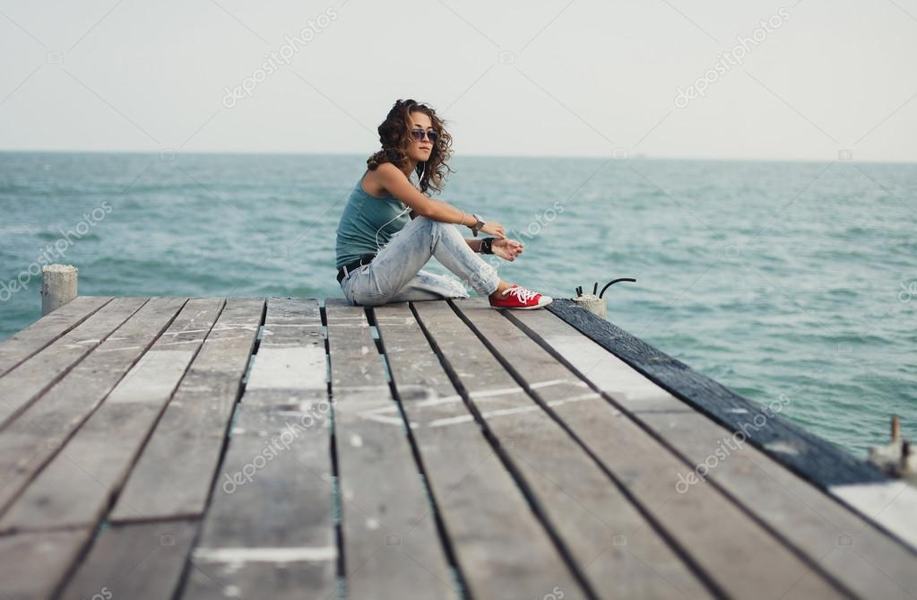 girl sitting in the pier