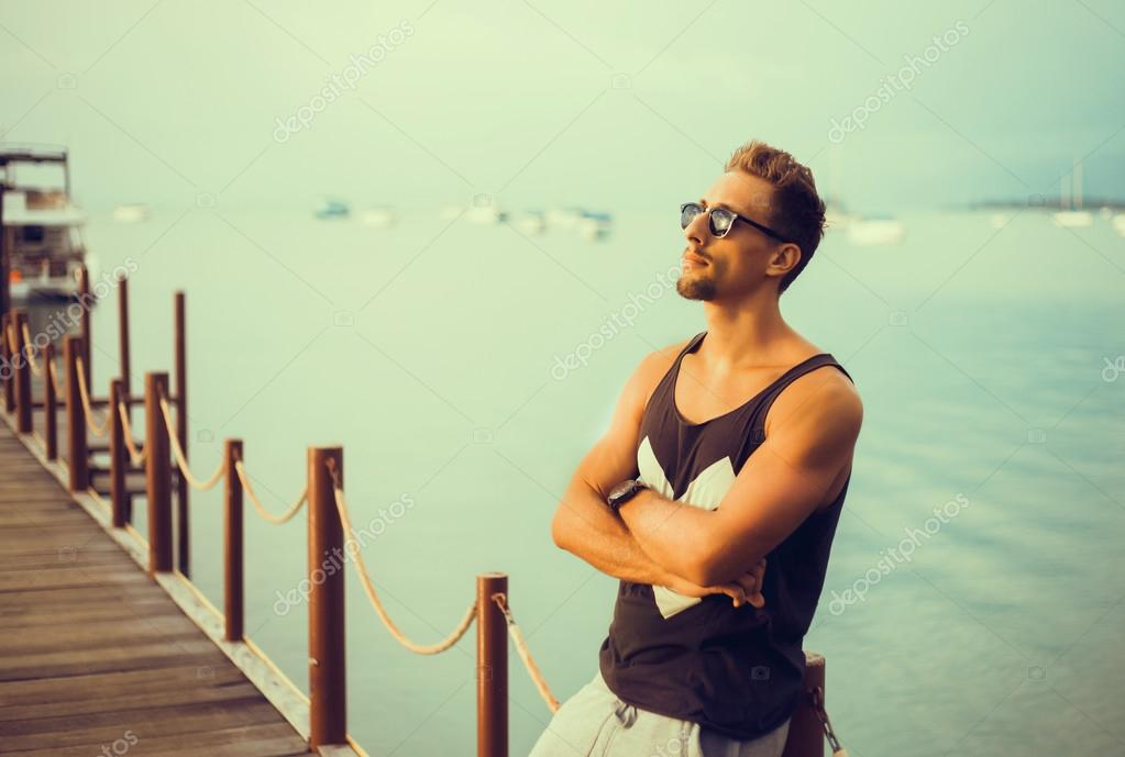 stylish young guy  on the pier
