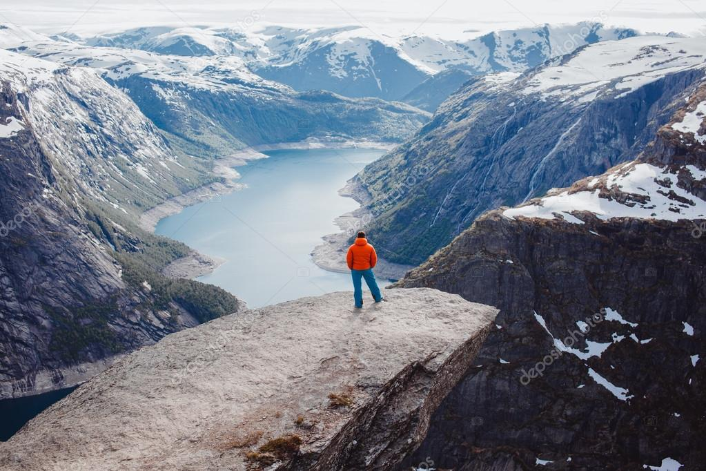 man posing at troll tongue,at Norway