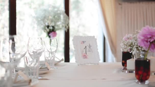 Modern Wedding Decorated Table. Frame with Numbers.  Place setting and card on a table at a wedding reception